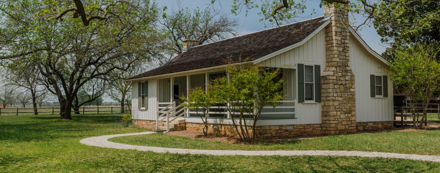 Exterior image of a small white ranch style home